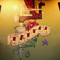 Photo taken at Tattoo Cafe by Eugene C. on 3/6/2012