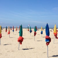 Photo taken at Plage de Deauville by Albina B. on 7/17/2012