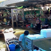 Photo taken at Taling Chan Floating Market by Prince L. on 6/9/2012