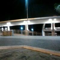 Photo taken at Anfiteatro da Ponta Negra by Shepstonon L. on 5/7/2012