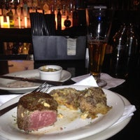 Photo taken at Ruth's Chris Steak House - Wilmington, NC by Brian D. on 3/14/2012