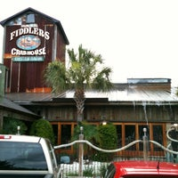 Photo taken at Fiddlers Crab House & Oyster Barn by Lizzy S. on 6/1/2012