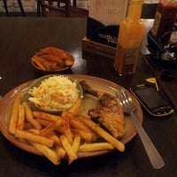 Photo taken at Nando's by Agnes T. on 9/1/2012