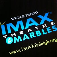 Photo taken at Wells Fargo IMAX Theatre at Marbles by Nathan M. on 3/23/2012