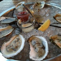 Photo taken at Henlopen City Oyster House by Renato S. on 8/26/2012