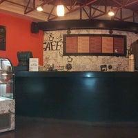Photo taken at Cafe 21 by Juan Manuel H. on 5/5/2012