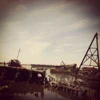 Photo taken at Staten Island Tugboat Graveyard by Charlotte C. on 5/12/2012