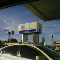 Photo taken at Chevron by elli r. on 2/5/2012