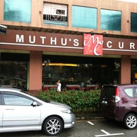 Photo taken at Muthu's Curry Restaurant by Amin C. on 3/18/2012