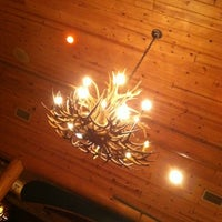 Photo taken at Grizzly's Wood-Fired Grill & Steaks by Amanda C. on 2/15/2012