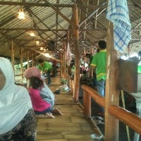 Photo taken at Saung Talaga by Agus K. on 7/14/2012