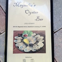 Photo taken at Magnolia's Oyster Bar by Christopher Z. on 2/11/2012