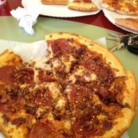 Photo taken at Singas Famous Pizza Hicksville by Jason R. on 7/27/2012