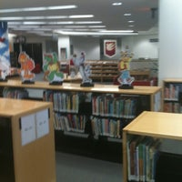 Photo taken at Sahara West Library by Felicia M. on 3/13/2012