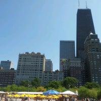 Photo taken at Oak Street Beach by Vianey C. on 7/8/2012
