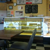 Photo taken at MJ's donuts by Tyler M. on 7/18/2012