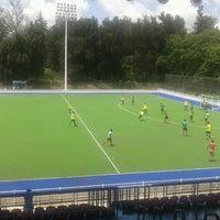 Photo taken at Estadio Panamericano de Hockey by Hector L. on 9/7/2012