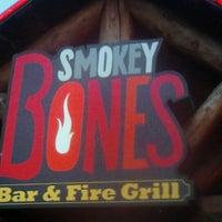 Photo taken at Smokey Bones Bar & Fire Grill by Teresa O. on 9/8/2012