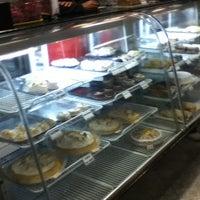 Photo taken at A Familiar Confeitaria by Murilo W. on 7/11/2012