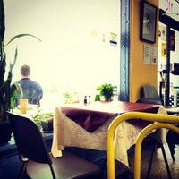 Photo taken at The New Deal Cafe by Matthew R. on 7/31/2012