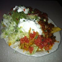 Photo taken at Champs Sports Grill by Tabitha M. on 2/10/2012