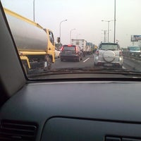 Photo taken at Toll  Priok Cawang km 8 by Rona M. on 7/27/2012