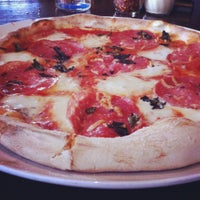 Photo taken at Pizza Republica by Logan W. on 7/15/2012