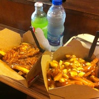 Photo taken at Smoke's Poutinerie by Angel N. on 6/19/2012