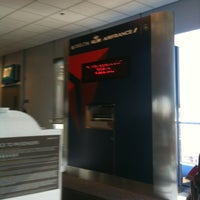 Photo taken at Concourse D by Alecia B. on 6/5/2012