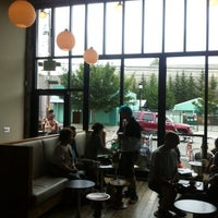 Photo taken at Stumptown Coffee Roasters by Erin G. on 8/18/2012