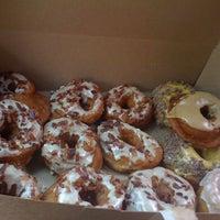 Photo taken at Dynamo Donut & Coffee by Jane C. on 5/6/2012