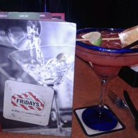 Photo taken at TGI Fridays by MELONIE O. on 9/8/2012