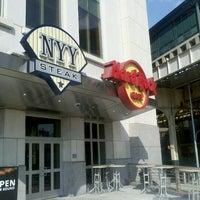 Photo taken at Hard Rock Cafe Yankee Stadium by Alexis N. on 3/13/2012
