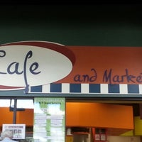 Photo taken at The Café & Market At Crossroads by E on 9/11/2012