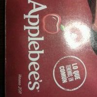 Photo taken at Applebee's by Marcela d. on 3/4/2012