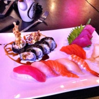 Photo taken at Fin Sushi & Sake Bar by Mike L. on 7/20/2012