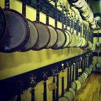 Photo taken at Gruhn Guitars by Jon D. on 8/1/2012