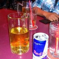 Photo taken at Puck Restaurant & Sports Bar by JoseR R. on 8/12/2012