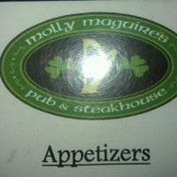 Photo taken at Molly Maguires Pub & Steakhouse by Kim B. on 4/15/2012