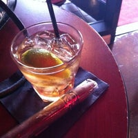 Photo taken at LIT Premium Cigar Lounge by Dennis P. on 3/31/2012