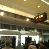 Photo taken at Gate A31 by Josh H. on 5/16/2012