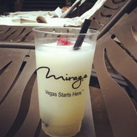 Photo taken at The Mirage Pool & Cabanas by Ashley on 7/4/2012