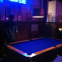 Photo taken at Honest John's Bar & No Grill by Ashley S. on 5/28/2012
