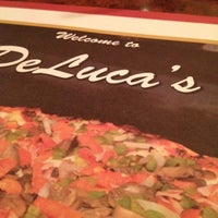 Photo taken at DeLuca's Restaurant and Pizzeria by Heidi M. on 7/29/2012