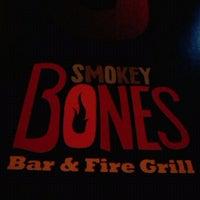 Photo taken at Smokey Bones Bar & Fire Grill by Harold C. on 4/1/2012