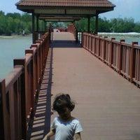 Photo taken at Jeti, Pantai Cahaya Negeri by Elle N. on 2/6/2012