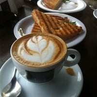 Photo taken at Lucca Café by William U. on 5/25/2012