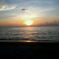 Photo taken at Layang-layangan Beach by San B. on 6/14/2012