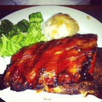 Photo taken at Smokey Bones Bar & Fire Grill by Briana H. on 7/1/2012