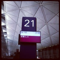 Photo taken at Gate 21 by Martha C. on 7/30/2012